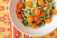 Zucchini noodles with cherry tomatoes, almonds and basil